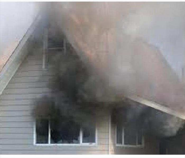 House with smoke out of windows